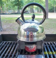 Kettle on Sterno on a grill